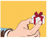 Hand holding beautiful gift box.Vector illustration
