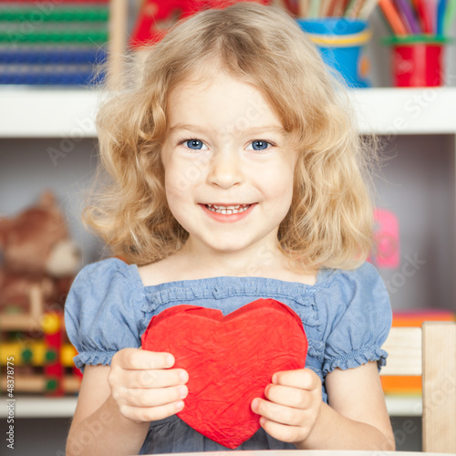 Child holding heart