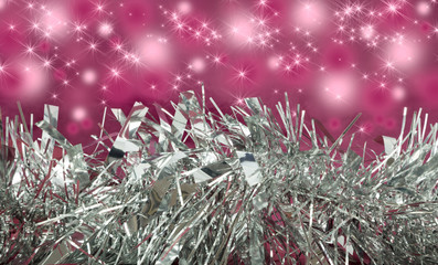 Silver Tinsel with pink sparkle background.