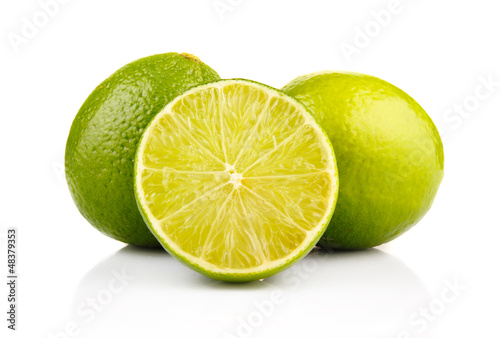 Ripe lime fruits with slices isolated on white