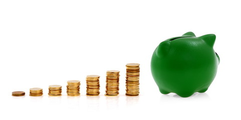 Green piggy bank and golden coins, creative business symbols