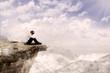 Businessman sitting on the edge