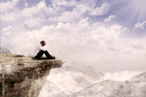 Businessman sitting on the edge