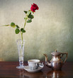 Espresso for one and red rose