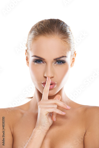 Woman making a shushing gesture