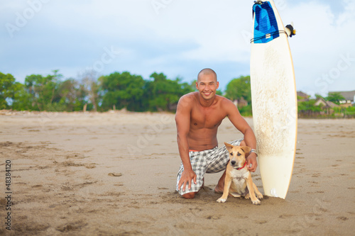 young man and dog