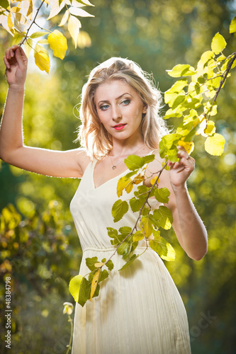 Young attractive woman in a romantic autumn scenery