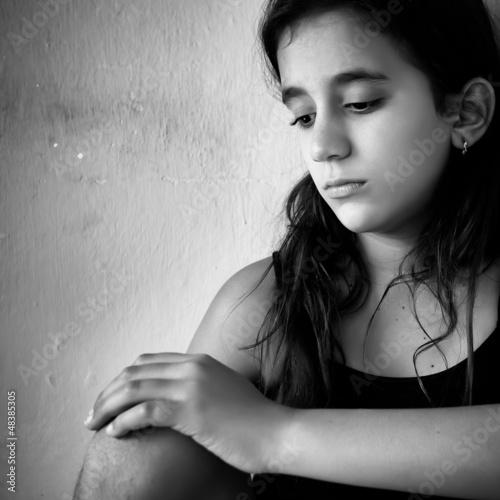 Hispanic girl with a very sad expression