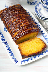 Jaffa drizzle loaf. Orange cake with chocolate glaze