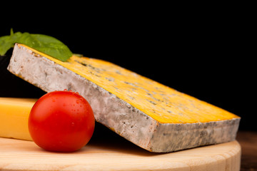 block of cheese and tomato on table