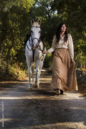 classical girl with a white horse
