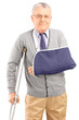 Injured mature man with broken arm walking with crutches