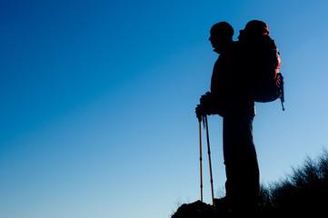 Silhouette of hiking man