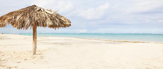 Beach umbrella on exotic caribbean plage.