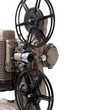 Close-up of a vintage movie projector on a white background