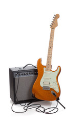 An amp and an electric guitar on a white background
