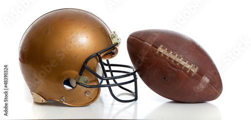 Foto op Aluminium Retro A retro gold football helmet and football on a white background