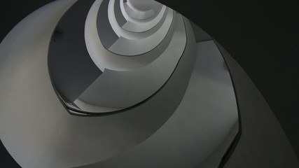 Modern interior with spiral staircase, view from down