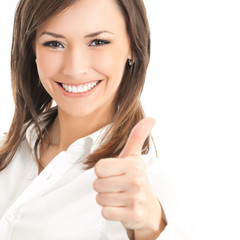 Happy businesswoman with thumbs up gesture