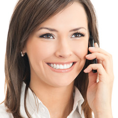 Happy businesswoman with cell phone, isolated