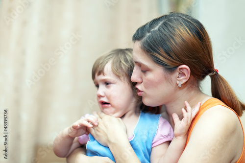 woman calms her daughter