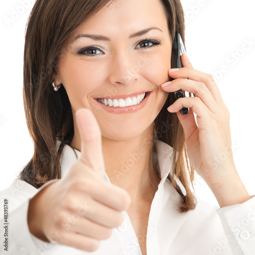 Businesswoman with cellphone and thumbs up