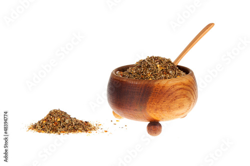 Mixed spices in wooden bowl - on white background