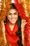 smiling woman in red dress isolated on christmas