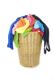 Full of colorful shirts in a wicker basket