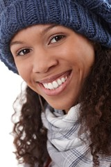 Closeup portrait of smiling afro woman in cap