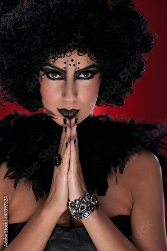Evil woman praying