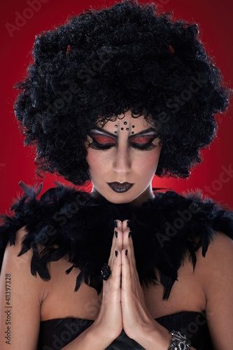 Praying devil