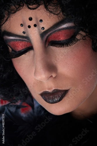 Closeup portrait of professional devil makeup