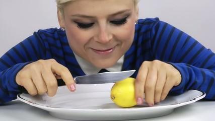 Woman Eating Lemon