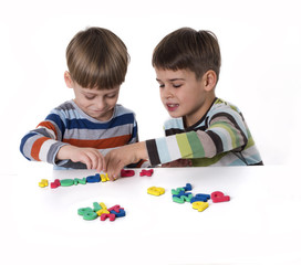 boys playing with rubber lettters