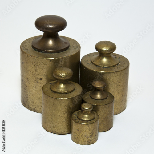 Five antique calibration weights isolated on white