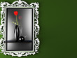 a red rose in the dark vase