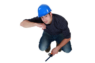 Crouching man with hammer