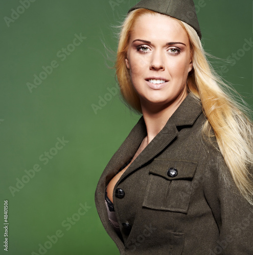 Beautiful woman  in military clothes