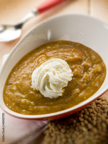 lentils cream soup with yogurt cream, selective focus