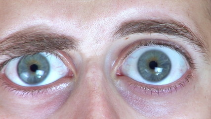 Man's eyes growing to unreal size due to surprise and shock