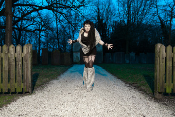 Gothic girl on cemetery.