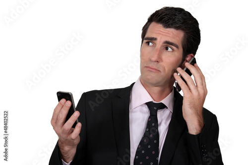 Man with two phones