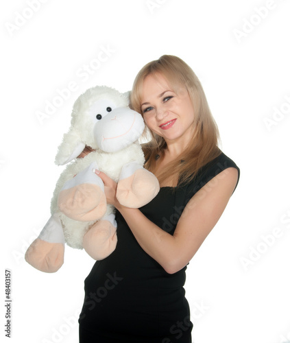 Happy woman with toy sheep over white