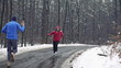 Men jogging in the forest in winter, super slow motion