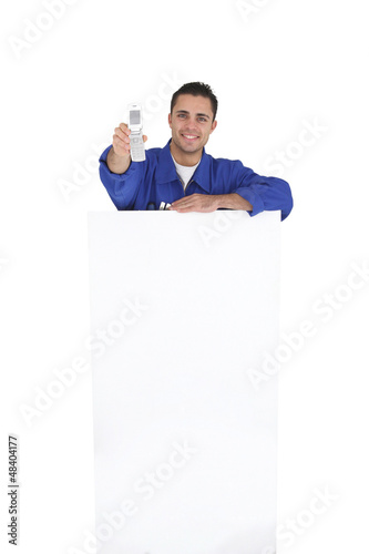Tradesman holding a mobile phone