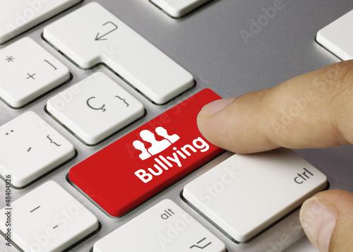 Bullying keyboard key. Finger