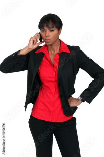 Serious businesswoman taking a call on a cellphone