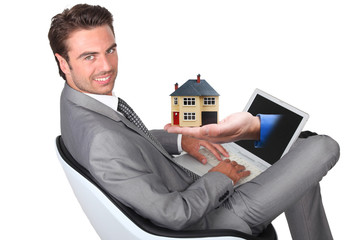 man sitting with laptop and hand sticking out of screen