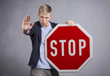 Man showing stop sign.